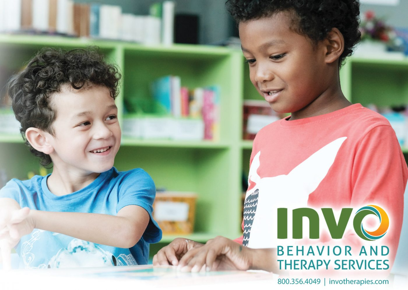 INVO Behavior and Therapy Services. Shows two little boys playing together and smiling,