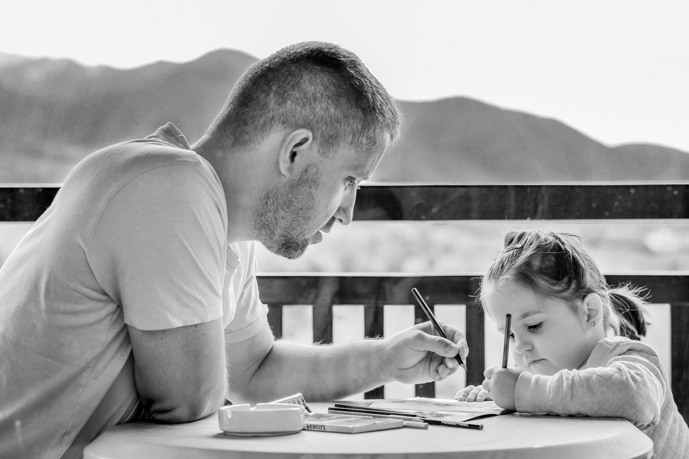 Man and young girl coloring
