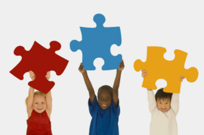 Children holding puzzle pieces.