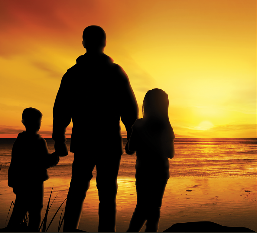 A man holding hands with a little boy and girl, watching a sunset at the beach,