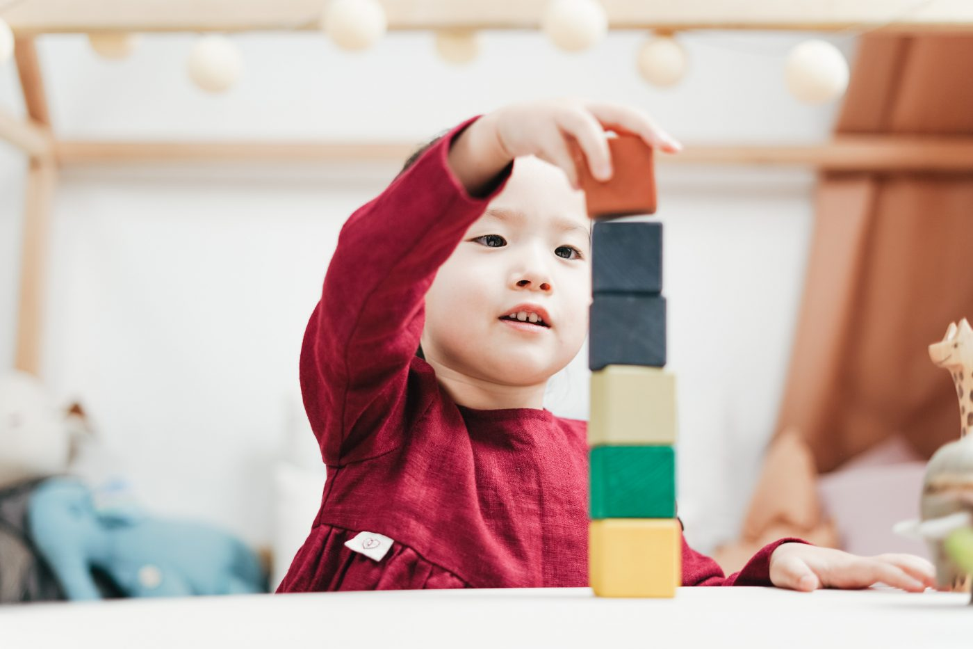 Little boy playing with color blocks